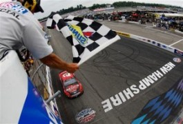 Brad Keselowski, driver of the #2 Redds Ford, takes the checkered flag to win the NASCAR Sprint Cup Series Camping World RV Sales 301 at New Hampshire Motor Speedway on July 13, 2014 in Loudon, New Hampshire. Photo by Brian Lawdermilk/NASCAR via Getty Images