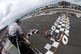 Austin Dillon, driver of the #3 Yuengling Light Lager Chevrolet, crosses the finish line to win the NASCAR Camping World Truck Series Pocono Mountains 150 at Pocono Raceway on August 2, 2014 in Long Pond, Pennsylvania. Photo by Chris Graythen/NASCAR via Getty Images