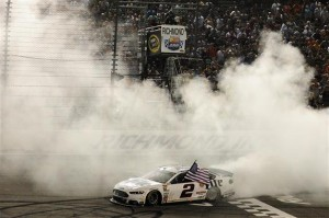 Brad Keselowski, driver of the #2 Miller Lite Ford, celebrates with a burnout after winning the NASCAR Sprint Cup Series Federated Auto Parts 400 at Richmond International Raceway on September 6, 2014 in Richmond, Virginia.  Photo by Rainier Ehrhardt/Getty Images