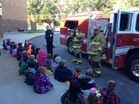 Fireman Kyle Hinds, Frank Lonigro, Dave Aquino and Brad Hazelton teach students a fire prevention class
