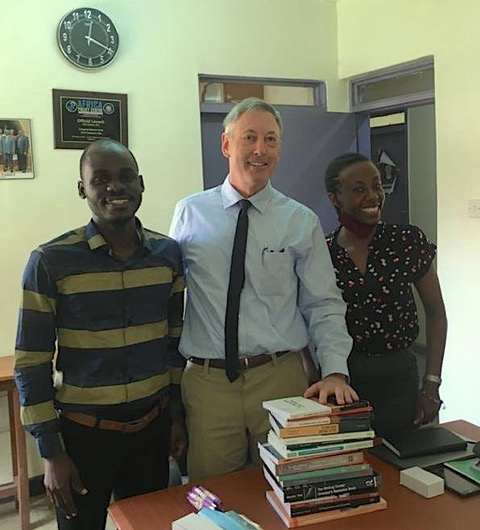 Deans with Martin Kajubi and Yvonne Birungi, writing instructors at UCU who are participating in planning sessions for a writing centre.