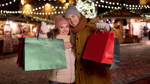 holidays, christmas and people concept - happy couple at with sh_336023