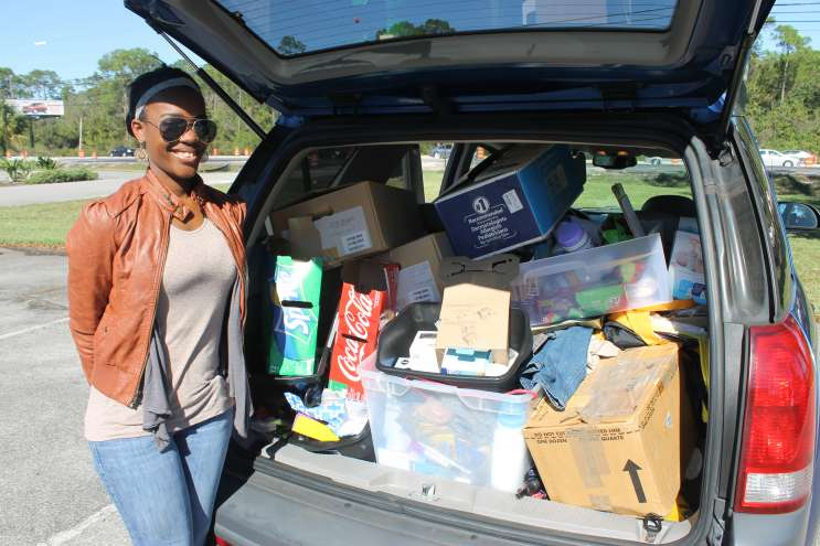 Briana Daniel with a car load of donations for her Street Team Movement. Photo: Matthew Peddie, WMFE