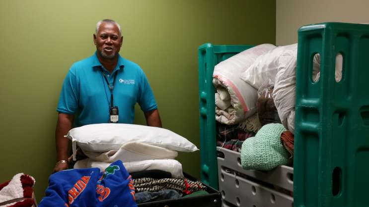 Staff and residents sort items donated by the community to keep the area's homeless warm. Photo: Central Florida Coalition for the Homeless.