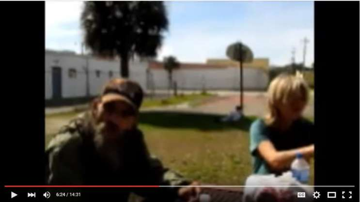A screenshot taken of a Youtube video in which a Daytona Beach couple speaks with the area's homeless who allege Mike Pastore is pocketing cash donations for a shelter. Photo: Youtube.
