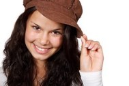 Smiling girl in brown cap