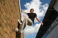 man climbing wall
