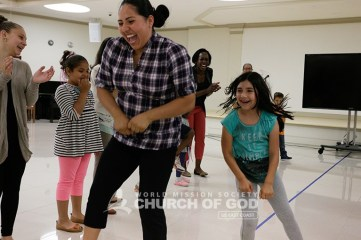 mommy and daughter, mom and child, dancing, dance, fun games, world mission society church of God, wmscog, love, family, funny face, love
