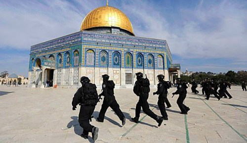 Israeli police run during clashes with stone-throwing Palestinians at the Temple Mount