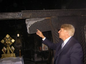 William Murray inspects the desecrated and fired Devic Monastery in Kosovo. Murray has witnessed firsthand the results of Islamic terror worldwide.
