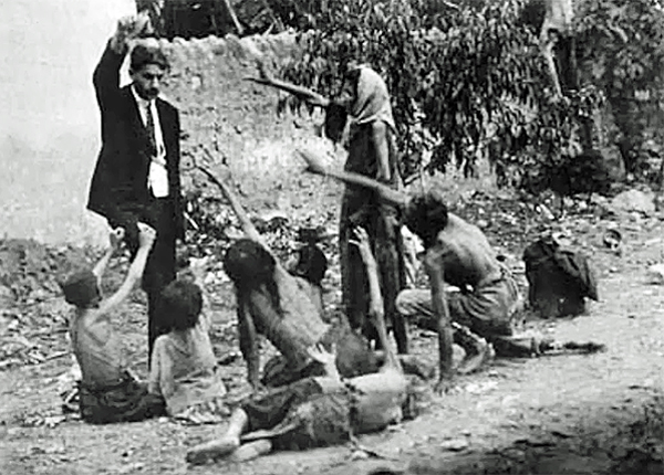 A Turkish official teases starving Armenian children by showing them a piece of bread during the Armenian Genocide