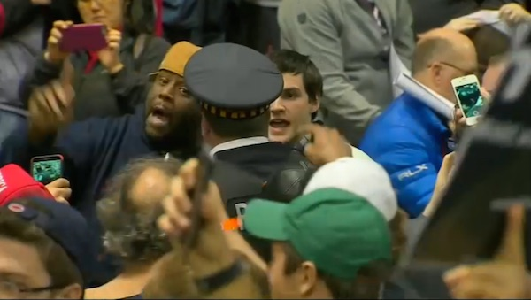 A man argues with a Chicago policeman during the aftermath of a postponed rally for Donald Trump (Photo: NBC 5 Chicago screenshot)