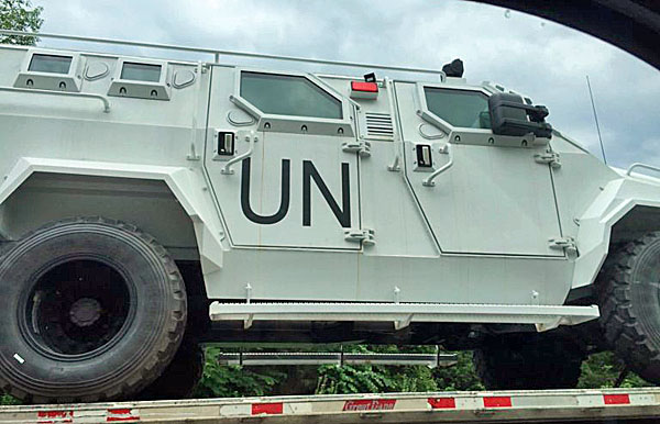 Bloggers were quick to point out the curiosity of U.N. trucks being transported on U.S. highways.