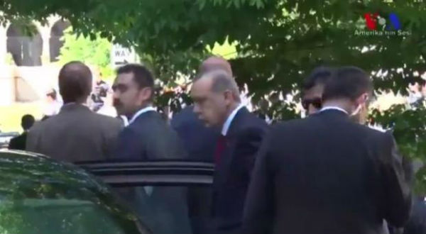 Turkish President Erdogan is seen surveying the violence before entering the Turkish ambassador's residence (Voice of America Turkish)