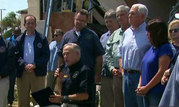 Texas Gov. Greg Abbott, accompanied by Vice President Mike Pence and Rev. Franklin Graham in Rockport, Texas, Aug. 31, 2017, declares Sunday a day of prayer in Texas.