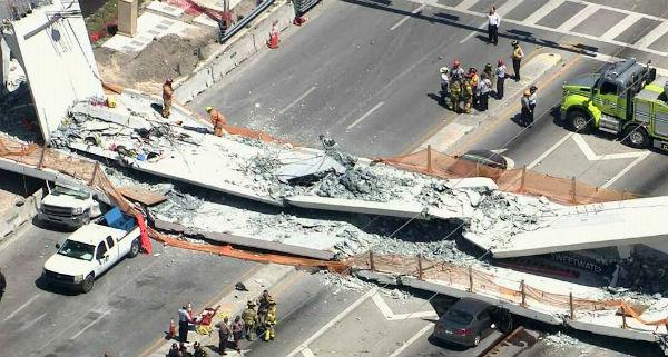 A concrete pedestrian bridge near Florida International University in Miami fell on to an eight-lane motorway on Thursday, killing at least six people.