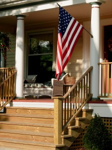bigstock-American-Flag-On-Porch-1383704