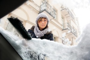 bigstock-person-removing-snow-and-ice-f-19423940