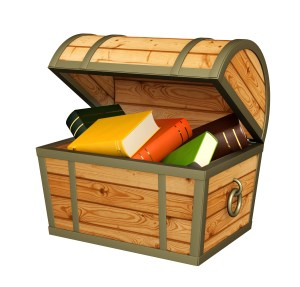 Books in wooden chest. Isolated over white