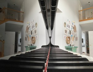 Piano keys with home reflected as well as the keys in the piano