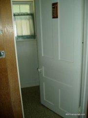 Bathroom door swinging in