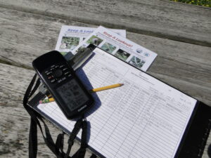 The tools of the trade - the WNY PRISM Crew uses GPS units, datasheets and species identification tools to survey for invasive species. Photo Credit: Nick Ransbury, WNY PRISM