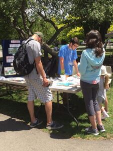 WNY PRISM Crew staffs an informational table at Buffalo Zoo's Party for Planet. Photo Credit:  WNY PRISM.