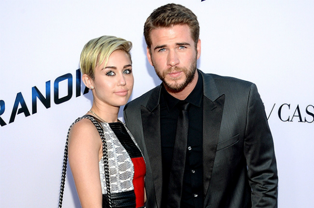 miley-cyrus-liam-hemsworth-red-carpet-650-430