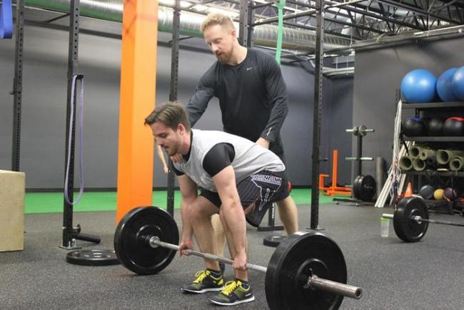 CrossFit ®* coach Christopher Crowder