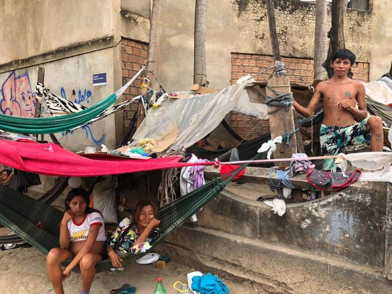 Three Yanonami people in informal settlements in the streets of Boa Vista