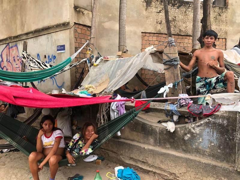 Three Yanonami people in informal settlements in the streets of Boa Vista