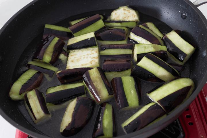 Boiling eggplant in a wok