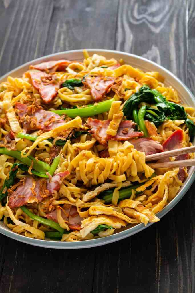 Egg noodles on a plate with chopsticks