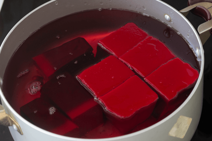 Uncooked blood jelly in a pot of water