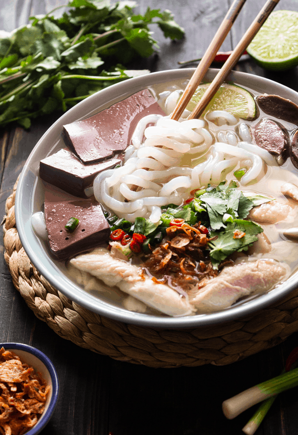 Bowl of Vietnamese Chicken Tapioca Noodle Soup (Bánh Canh Gà) with chopsticks in it