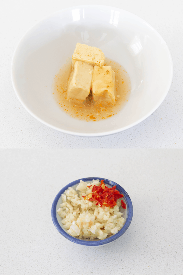 Fermented bean curd in a bowl and chopped garlic and chilli in a dish