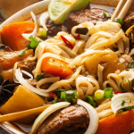 Beef stew and noodles in a bowl