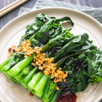 Chinese broccoli with oyster sauce and garlic on a plate