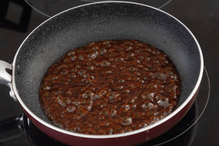 Oyster sauce bubbling in a pan