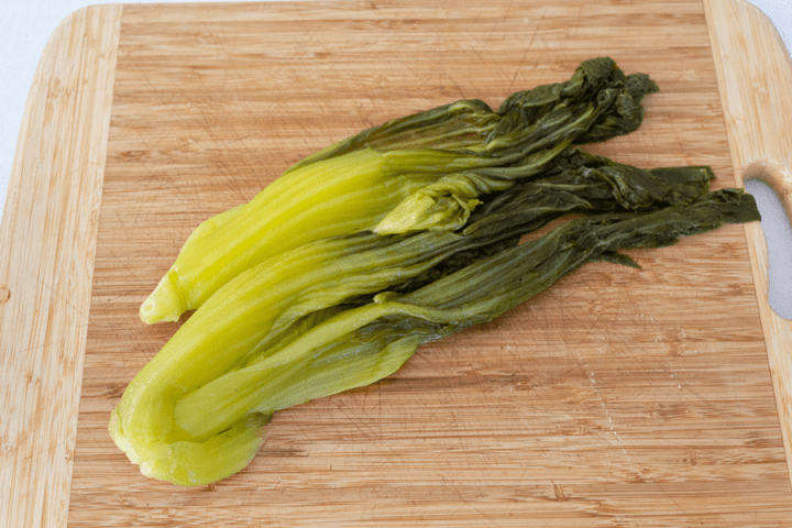 Pickled mustard greens on a board