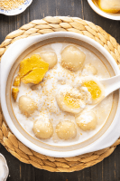 Glutinous rice balls in a bowl with a spoon