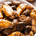 Chicken wings and mushrooms in a bowl