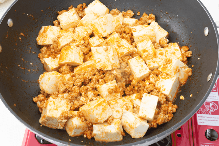 Diced tofu and mince in a wok