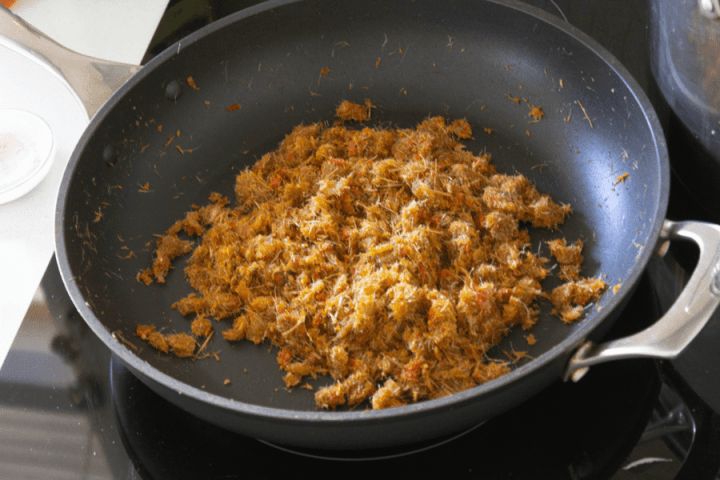 Blitzed lemongrass and chili brown in a pan
