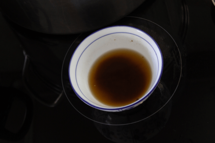 Tamarind paste in water in a bowl