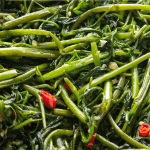 Stir Fried Water Spinach with Shrimp Paste on a plate