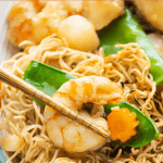 Our Crispy Egg Noodles with Seafood promises Chinese restaurant quality flavors. Break into crunchy noodles smothered in a thick glaze! #chineseeggnoodles #sesafoodeggnoodles #crispyeggnoodles