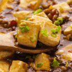 Mapo Tofu with Pork Mince scooped up by a spoon