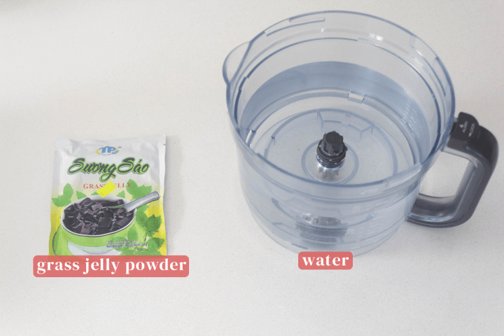 A packet of grass jelly premix along with a food processor of water.
