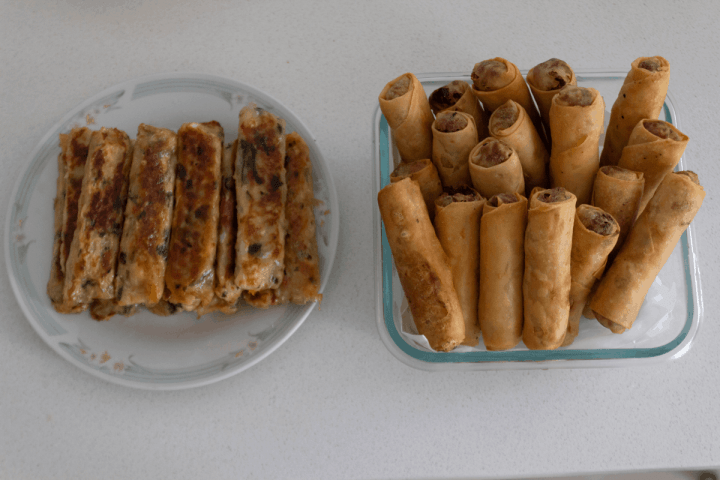 Fried vegetarian spring rolls and sugar cane prawn in dishes.